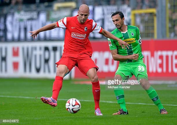 Dani Shahin of Freiburg challenges Martin Stranzl of Borussia Moenchengladbach during the Bundesliga match between SC Freiburg and Borussia...