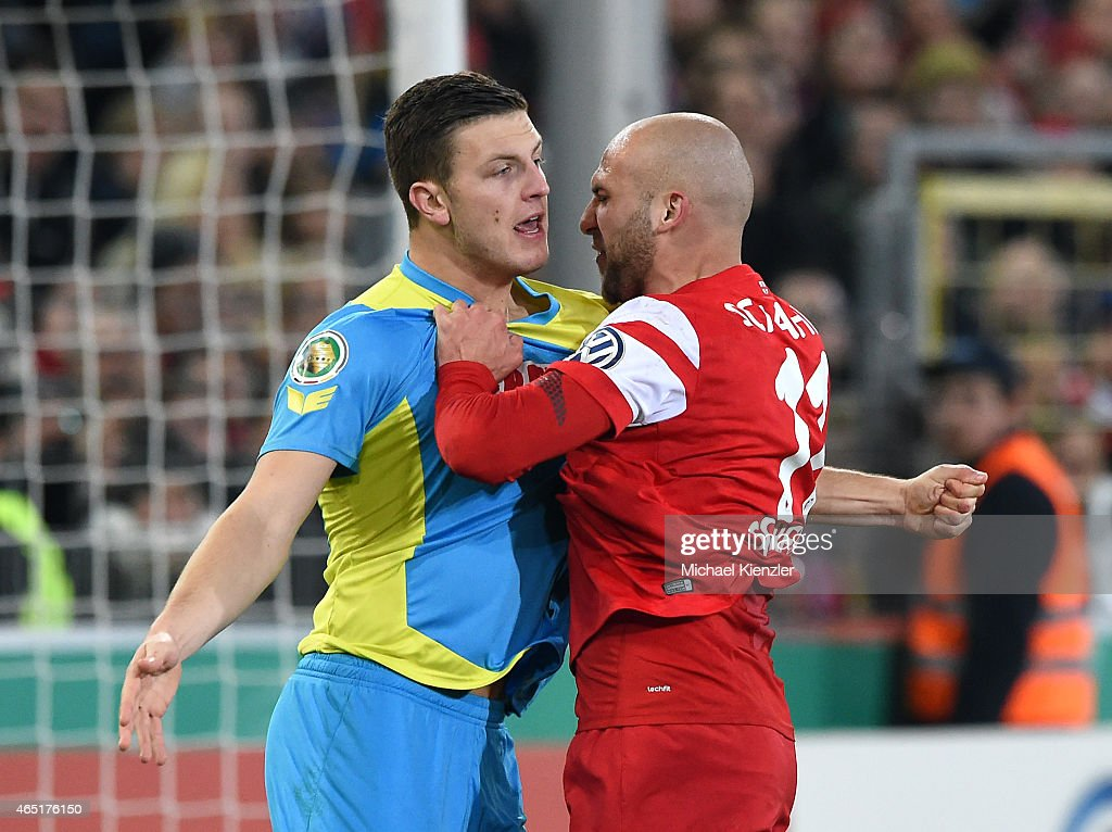 Dani Shahin (R) of SC Freiburg challenges Kevin Wimmer (L) of 1. FC Koeln during the DFB Cup between SC Freiburg and 1. FC Koeln at Schwarzwald-Stadium on March 3, 2015 in Freiburg, Germany.