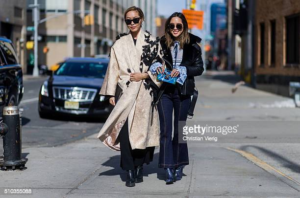 Dani Song is wearing a gold La Boutique butterfly coat and Aimee Song seen outside Rebecca Minkoff during New York Fashion Week Women's Fall/Winter...