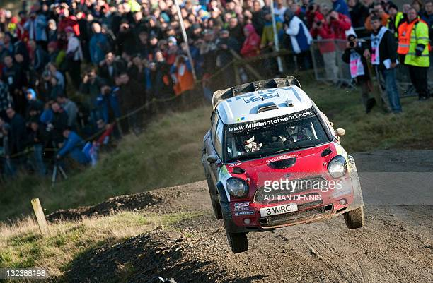 Dani Sordo and codriver Carlos Del Barrio of Spain jumps his Mini John Coooper works car on the Sweet Lamb stage during the third day of the Wales...