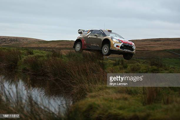 Dani Sordo of Spain and codriver Carlos Del Barrio drive their Citroën DS3 WRC over a jump on the Sweet Lamb stage of the FIA World Rally...