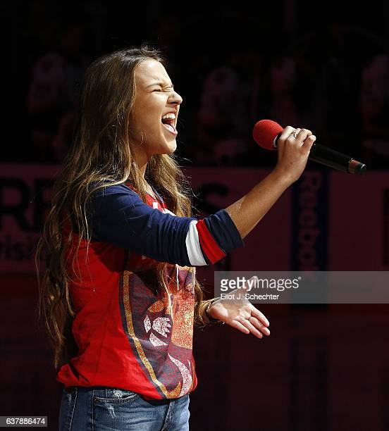 Dani Stocksdale belts out a powerful rendition of the Star Spangled Banner prior to the start of the game between the Nashville Predators and the...