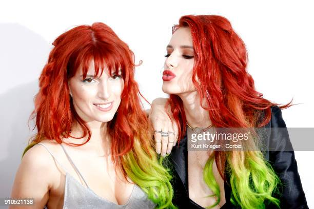 Dani Thorne and sister Bella Thorne arrive at the 2016 American Music Awards at the Microsoft Theater on November 20 2016 in Los Angeles California...