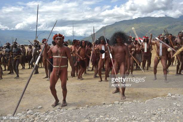 Dani tribe men perform a mock tribal war in Walesi district in Wamena Papua Province on August 8 2016 The performances at the 27th Baliem valley...