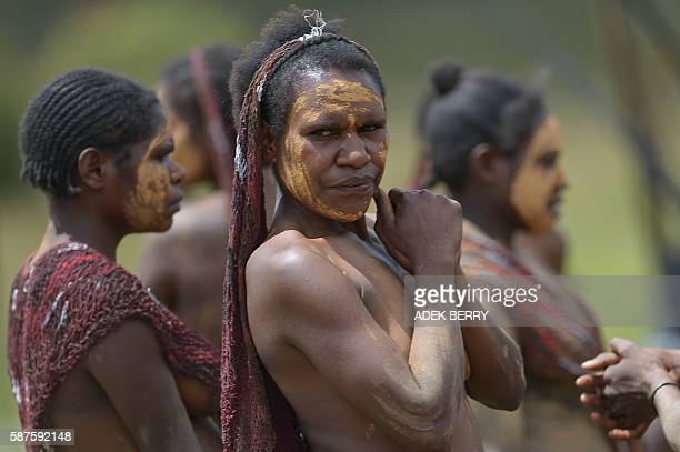 Dani tribeswomen participate in the 27th annual Baliem Valley Festival in Walesi district in Wamena, Papua Province on August 9, 2016. Performances...