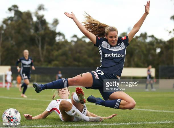 Dani Weatherholt of the Victory is tackled by Courtney Nevin of the Wanderers during the round five WLeague match between the Melbourne Victory and...