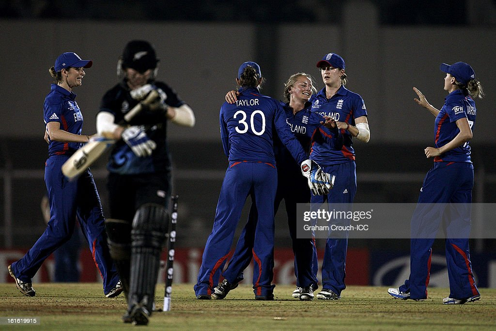 Dani Wyatt (C) of England celebrates the wicket of Katie Perkins of New Zealand during the Super Sixes ICC Women's World Cup India 2013 match between New Zealand and England at the Cricket Club of India ground on February 13, 2013 in Mumbai, India.