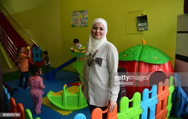 Dania Abdulbaqi creche owner poses during an interview with AFP in Gaziantep in the southwest province of Turkey on May 2 2018 In the Turkish city of...