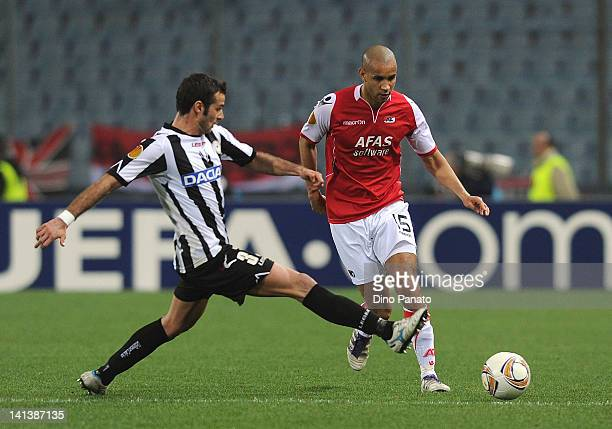 Daniano Ferronetti of Udinese competes for the ball with Simon Busk Poulsen of AZ Alkmaar during the UEFA Europa League Round of 16 second leg match...