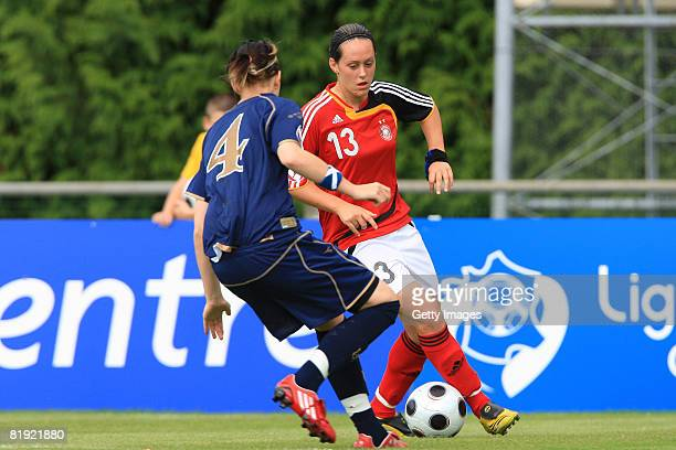 Danica Dalziel of Scotland and Lisa Schwab of Germany fight for the ball during the Women's U19 European Championship match between Scotland and...