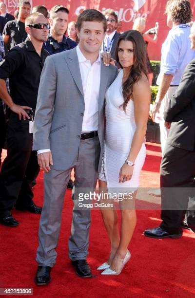 Danica Patrick and Ricky Stenhouse Jr arrive at the 2014 ESPY Awards at Nokia Theatre LA Live on July 16 2014 in Los Angeles California