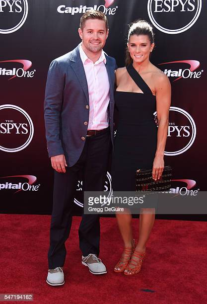 Danica Patrick and Ricky Stenhouse Jr arrive at The 2016 ESPYS at Microsoft Theater on July 13 2016 in Los Angeles California