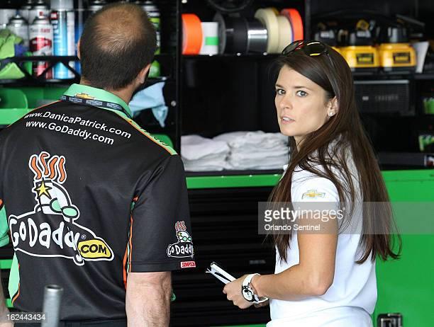 Danica Patrick appears in her garage before the start of the Nationwide 300 race at Daytona International Speedway in Daytona Beach Florida Saturday...