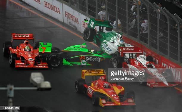 Danica Patrick crashes her GoDaddycom Andretti Autosport Honda Dallara in to Simona de Silvestro in her Nuclear Clean Air Energy HVM Racing Honda...