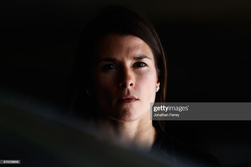 Danica Patrick, driver of the #10 Aspen Dental $10M for Veterans Ford, poses in the garage area during practice for the Monster Energy NASCAR Cup Series AAA Texas 500 at Texas Motor Speedway on November 4, 2017 in Fort Worth, Texas.