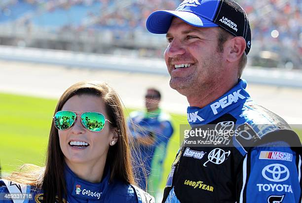 Danica Patrick driver of the Aspen Dental Chevrolet and Clint Bowyer driver of the PEAK Antifreeze Coolant Toyota talk on the grid prior to the...
