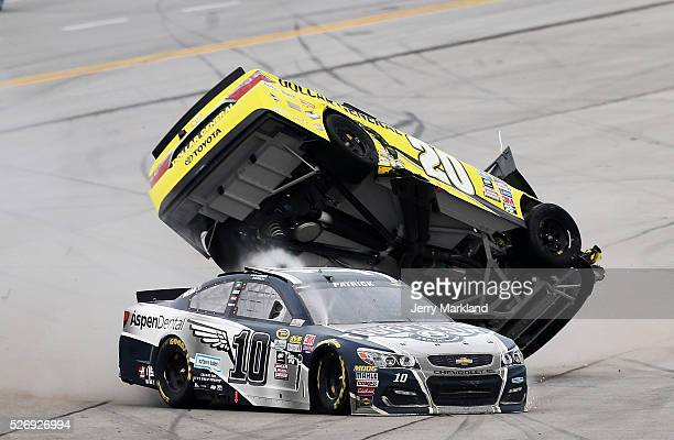 Danica Patrick driver of the Aspen Dental Chevrolet and Matt Kenseth driver of the Dollar General Toyota are involved in an on track incident during...