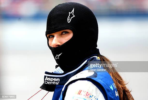 Danica Patrick driver of the Aspen Dental Chevrolet stands on the grid during qualifying for the NASCAR Sprint Cup Series GEICO 500 at Talladega...