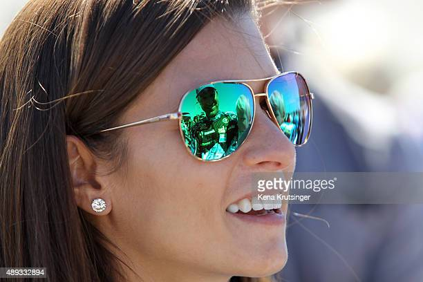 Danica Patrick driver of the Aspen Dental Chevrolet talks with Clint Bowyer driver of the PEAK Antifreeze Coolant Toyota during the NASCAR Sprint Cup...