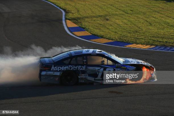 Danica Patrick driver of the Aspen Dental Ford is involved in an ontrack incident during the Monster Energy NASCAR Cup Series Championship Ford...