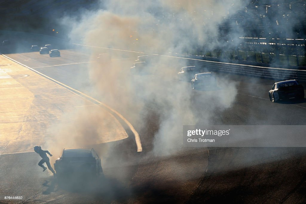 Danica Patrick, driver of the #10 Aspen Dental Ford, runs from her car after being involved in an on-track incident during the Monster Energy NASCAR Cup Series Championship Ford EcoBoost 400 at Homestead-Miami Speedway on November 19, 2017 in Homestead, Florida.