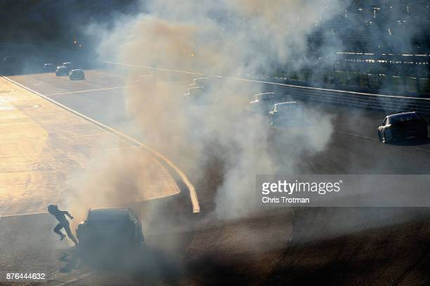 Danica Patrick driver of the Aspen Dental Ford runs from her car after being involved in an ontrack incident during the Monster Energy NASCAR Cup...