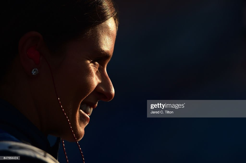 Danica Patrick, driver of the #10 Aspen Dental Ford, stands on the grid during qualifying for the Monster Energy NASCAR Cup Series Tales of the Turtles 400 at Chicagoland Speedway on September 15, 2017 in Joliet, Illinois.