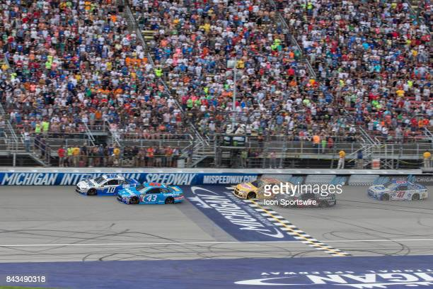 Danica Patrick driver of the Code 3 Associates Ford Aric Almirola driver of the Smithfield Ford Ryan Newman driver of the Velveeta Shells Cheese...