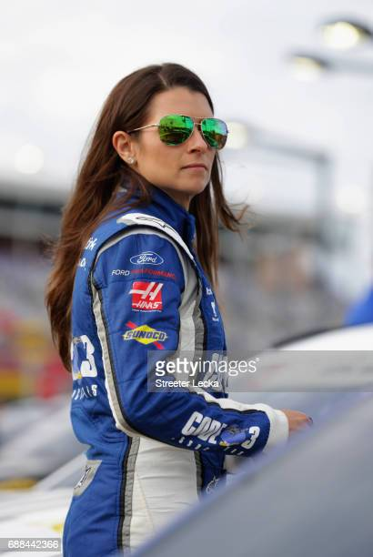 Danica Patrick driver of the Code 3 Associates Ford stands on the grid during qualifying for the Monster Energy NASCAR Cup Series CocaCola 600 at...