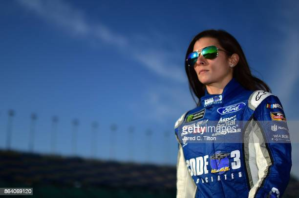 Danica Patrick driver of the Code 3 Associates Ford walks to her car on the grid during qualifying for the Monster Energy NASCAR Cup Series Hollywood...