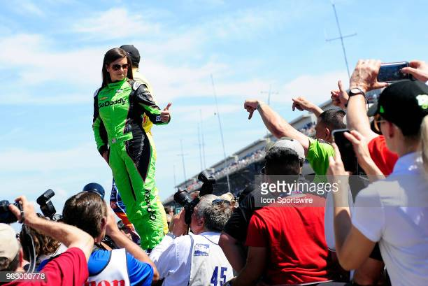 Danica Patrick driver of the Ed Carpenter Racing Chevrolet gives a fan a thumbs up during driver introductions for the IndyCar Series Indianapolis...