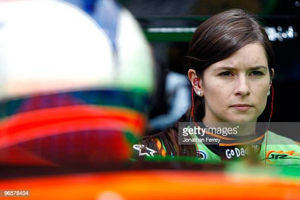 Danica Patrick driver of the Go Daddy Chevrolet stands in the garage area during practice for the NASCAR Nationwide Series DRIVE4COPD 300 at Daytona...