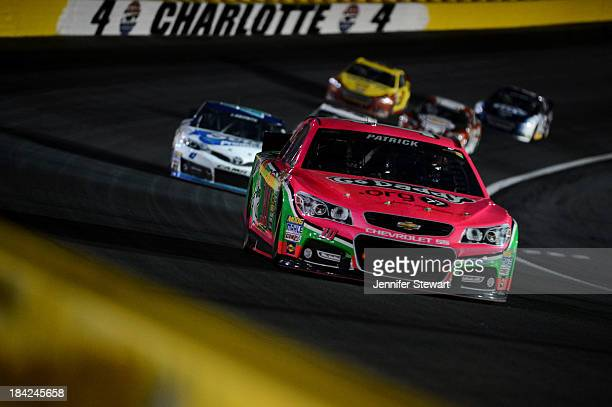 Danica Patrick driver of the GoDaddy Breast Cancer Awareness Chevrolet leads a group of cars during the NASCAR Sprint Cup Series Bank of America 500...