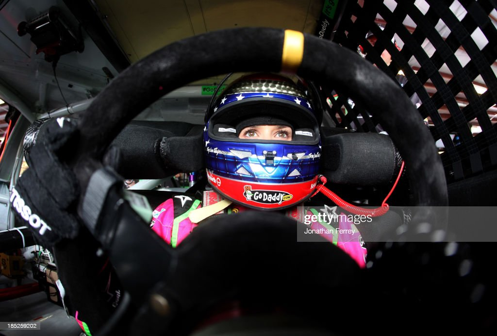 Danica Patrick, driver of the #10 GoDaddy Breast Cancer Awareness Chevrolet, sits in her car during practice for the NASCAR Sprint Cup Series 45th Annual Camping World RV Sales 500 at Talladega Superspeedway on October 18, 2013 in Talladega, Alabama.
