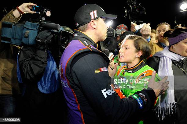 Danica Patrick driver of the GoDaddy Chevrolet and Denny Hamlin driver of the FedEx Express Toyota talk about their inrace incident on pit road after...