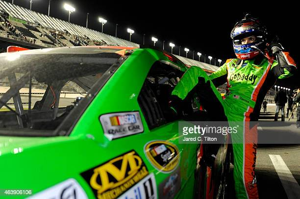 Danica Patrick driver of the GoDaddy Chevrolet climbs from her car on pit road following the NASCAR Sprint Cup Series Budweiser Duel 2 at Daytona...
