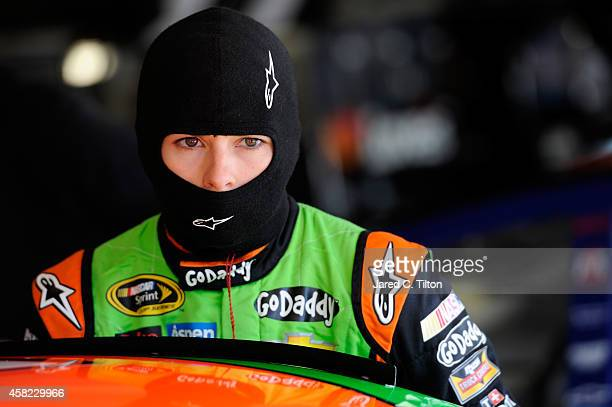Danica Patrick, driver of the GoDaddy Chevrolet, climbs into her car in the garage area during practice for the NASCAR Sprint Cup Series AAA Texas...
