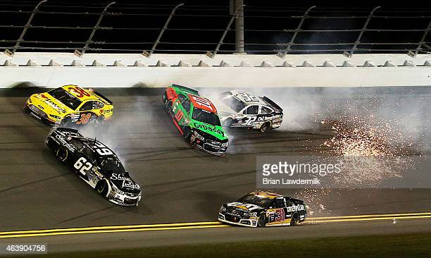 Danica Patrick driver of the GoDaddy Chevrolet is involved in an ontrack incident with Ryan Newman driver of the Caterpillar Chevrolet and Brian...