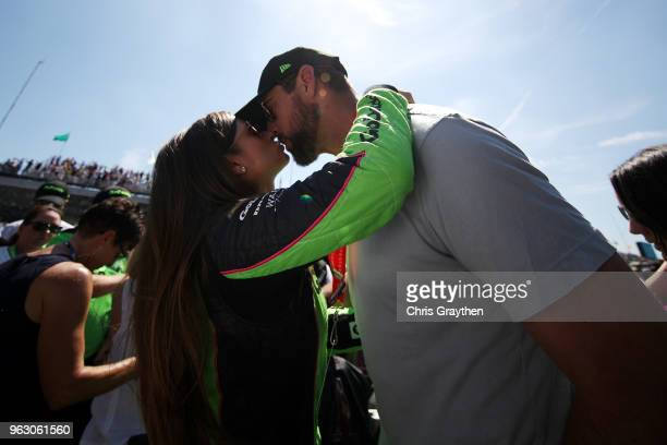 Danica Patrick driver of the GoDaddy Chevrolet kisses Aaron Rodgers prior to the 102nd Running of the Indianapolis 500 at Indianapolis Motorspeedway...