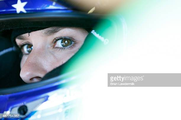Danica Patrick driver of the GoDaddy Chevrolet looks on from her car during practice for the NASCAR Sprint Cup Series Federated Auto Parts 400 at...