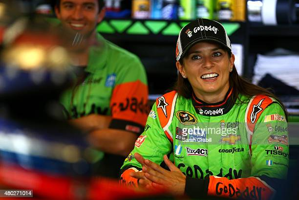 Danica Patrick, driver of the GoDaddy Chevrolet, looks on in the garage area during practice for the NASCAR Sprint Cup Series Quaker State 400...