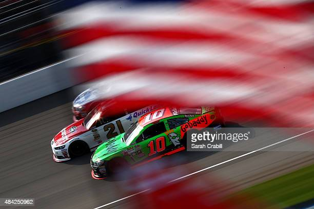 Danica Patrick driver of the GoDaddy Chevrolet Ryan Blaney driver of the Motorcraft/Quick Lane Tire Auto Center Ford and AJ Allmendinger driver of...