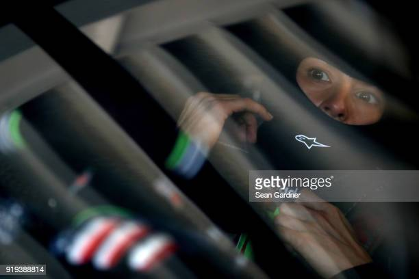 Danica Patrick driver of the GoDaddy Chevrolet sits in her car during practice for the Monster Energy NASCAR Cup Series Daytona 500 at Daytona...