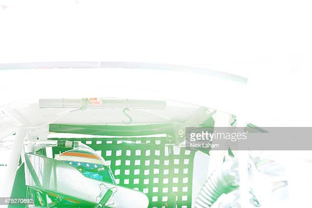 Danica Patrick driver of the GoDaddy Chevrolet sits in her car in the garage area during practice for the NASCAR Sprint Cup Series FedEx 400...