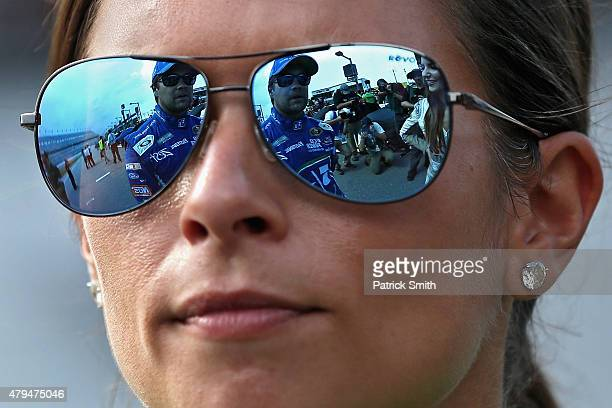 Danica Patrick driver of the GoDaddy Chevrolet speaks with Ricky Stenhouse Jr driver of the Fifth Third Bank Ford during qualifying for the NASCAR...