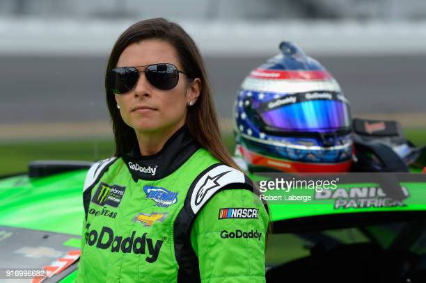 Danica Patrick driver of the GoDaddy Chevrolet stands by her car during qualifying for the Monster Energy NASCAR Cup Series Daytona 500 at Daytona...