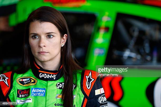 Danica Patrick driver of the GoDaddy Chevrolet stands in the garage during practice for the NASCAR Sprint Cup Series Sprint Unlimited at Daytona...