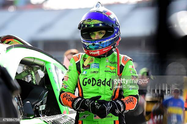 Danica Patrick driver of the GoDaddy Chevrolet stands in the garage area during practice for the NASCAR Sprint Cup Series Coke Zero 400 at Daytona...