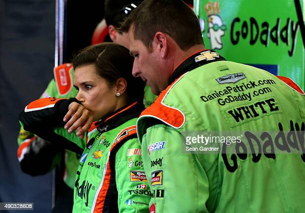 Danica Patrick driver of the GoDaddy Chevrolet stands in the garage area after being involved in an ontrack incident during the NASCAR Sprint Cup...