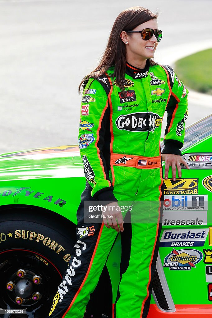 Danica Patrick, driver of the #10 GoDaddy Chevrolet, stands on pit road during qualifying for the NASCAR Sprint Cup Series Showdown at Charlotte Motor Speedway on May 17, 2013 in Concord, North Carolina.